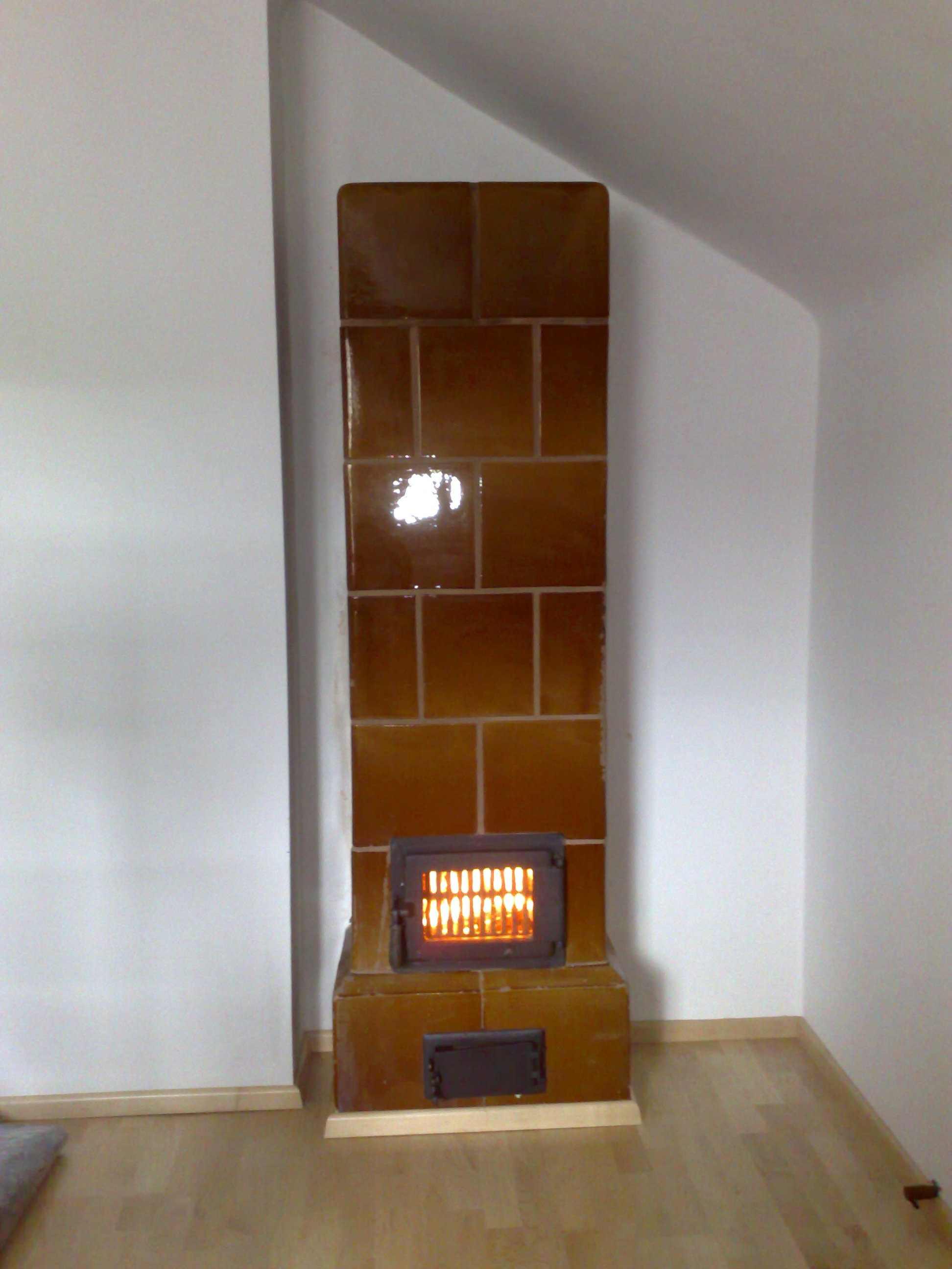 Reparatur und Einbau Feuerraumtuere alter Ofen